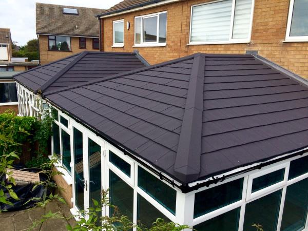 Solid black tiled conservatory roof to match their neighbour for client in the Blackpool area