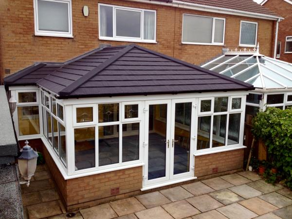 Replacement conservatory roof in black slate style for a Blackpool customer